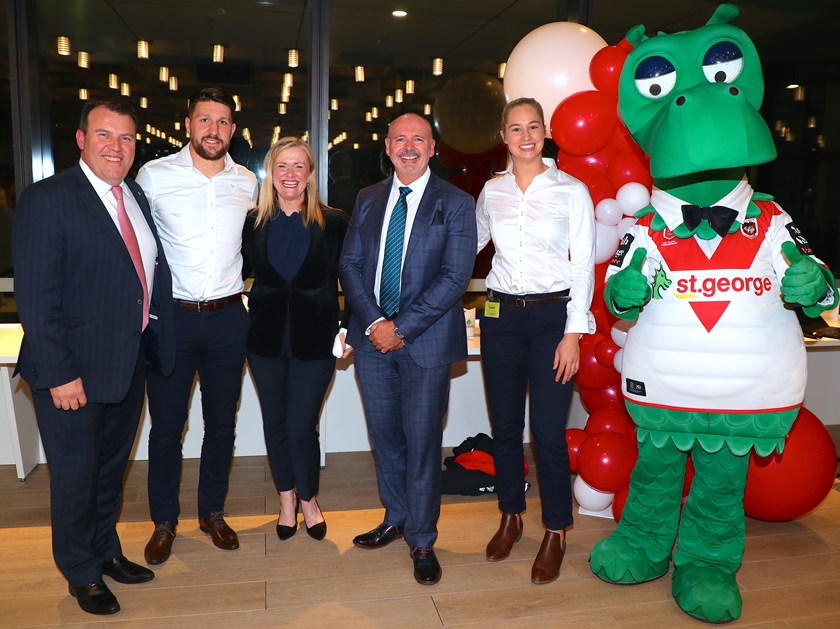 (L-R) General Manager St.George Business Bank Stuart Zalunardo, Dragons skipper Gareth Widdop, General Manger St.George Private Wealth Cathy Yuncken, General Manager for St.George Bank Ross Miller, NRL Women's Premiership player Kezie Apps and Happy Dragon celebrate the announcement.