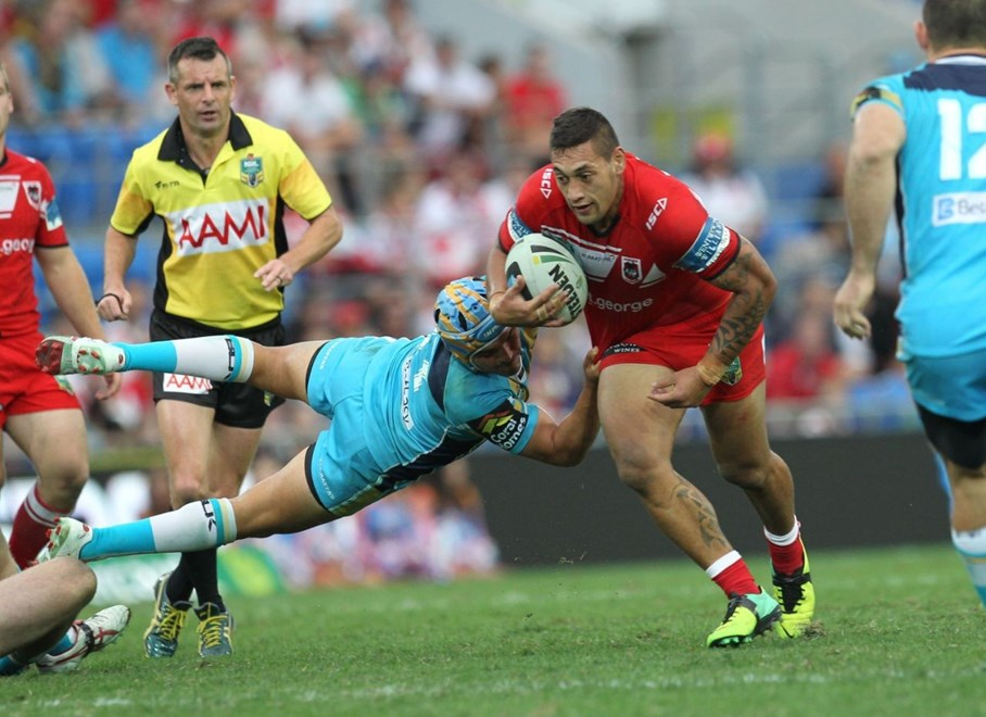 Photo by Colin Whelan copyright © nrlphotos.com :         Shane Pumipi grabbed by the flying Matt Srama                      NRL Rugby League, Round 15 Gold Coast Titans v St George Illawarra Dragons at Robina, Sunday June 22nd 2014.