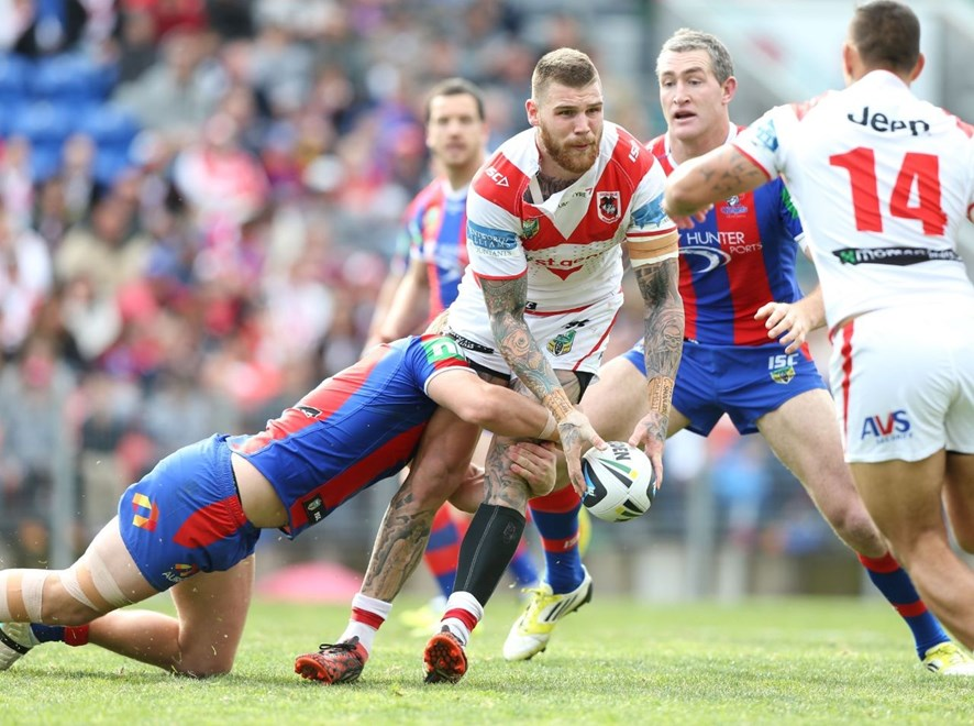Photo by Anthony Johnson copyright © nrlphotos.com: Josh Dugan gets a pass away.  NRL Rugby League, Round 26, Newcastle Knights v St George Illawarra Dragons at Hunter Stadium, Newcastle. Sunday September 7th, 2014